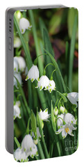 Blooming Snow Drop Lily Flowers In The Wild Portable Battery Charger by DejaVu Designs