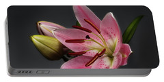 Blossoming Pink Lily Flower On Dark Background Portable Battery Charger