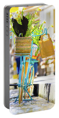 Blue Bicycle With A Basket Full Of Yellow Daffodils Portable Battery Charger