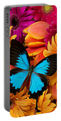 Blue Butterfly On Brightly Colored Flowers Portable Battery Charger by Garry Gay