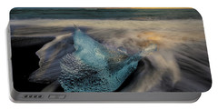 Portable Battery Charger featuring the photograph Blue Ice Stranding by Rikk Flohr