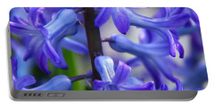 Portable Battery Charger featuring the photograph Blue Rhapsody by Byron Varvarigos