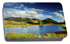 Portable Battery Charger featuring the photograph Blue Skies Over Crested Butte by John De Bord
