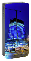 Portable Battery Charger featuring the photograph Blue Tower Rising by Randy Scherkenbach