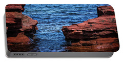 Portable Battery Charger featuring the photograph Blue Water Between Red Stone by Chris Bordeleau