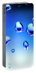 Blue Water Droplets On Glass Portable Battery Charger
