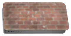 Portable Battery Charger featuring the photograph Blurred Orange Brick Wall,floor Exterior,interior Pattern Design by Jingjits Photography
