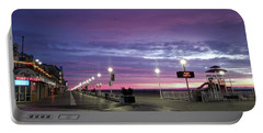 Portable Battery Charger featuring the photograph Boards Under Colorful Skies by Robert Banach