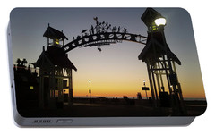 Portable Battery Charger featuring the photograph Boardwalk Arch At Dawn by Robert Banach