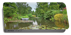 Portable Battery Charger featuring the photograph Boat On The Lake by Gill Billington