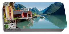 Portable Battery Charger featuring the photograph Boathouse With Mountains And Reflection In The Fjord In Norway by IPics Photography