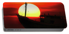 Boatman Enjoying Sunset Portable Battery Charger