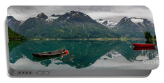 Portable Battery Charger featuring the photograph Boats And Mountain Reflection In The Water In Panorama by IPics Photography