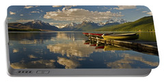 Portable Battery Charger featuring the photograph Boats At Lake Mcdonald by Gary Lengyel