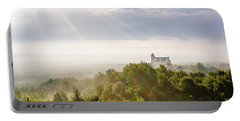 Portable Battery Charger featuring the photograph Bobolice Castle In The Morning Haze by Dmytro Korol