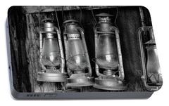 Portable Battery Charger featuring the photograph Bodie Lanterns by Tom Singleton