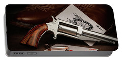 Portable Battery Charger featuring the photograph Boot Gun Still Life by Tom Mc Nemar