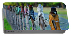 Portable Battery Charger featuring the photograph Boots On The Fence by Linda Unger