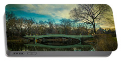 Portable Battery Charger featuring the photograph Bow Bridge Reflection by Chris Lord