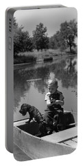 Boy With Dog In Fishing Boat Portable Battery Charger