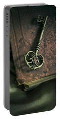 Brass Ornamented Key On Old Brown Book Portable Battery Charger
