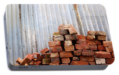 Portable Battery Charger featuring the photograph Brick Piled by Stephen Mitchell