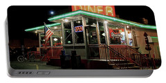 Portable Battery Charger featuring the photograph Broadway Diner by Christopher McKenzie