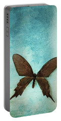 Brown Butterfly Over Blue Textured Background Portable Battery Charger