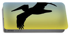 Brown Pelican In Flight Silhouette At Sunrise Portable Battery Charger