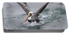 Brown Pelican Landing On Water . 7d8372 Portable Battery Charger