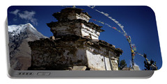 Portable Battery Charger featuring the photograph Buddhist Gompa And Prayer Flags In The Himalaya Mountains, Nepal by Raimond Klavins