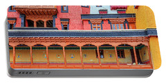 Portable Battery Charger featuring the photograph Buddhist Monastery Building by Alexey Stiop