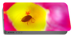 Bug In Pink And Yellow Flower  Portable Battery Charger by Ben and Raisa Gertsberg