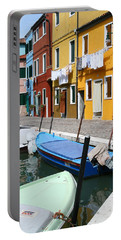 Portable Battery Charger featuring the photograph Burano Corner With Laundry by Donna Corless