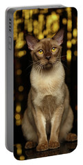 Burmese Cat Sits On New Year Background Portable Battery Charger