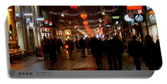 Portable Battery Charger featuring the photograph Busy Shoppers by Inge Riis McDonald