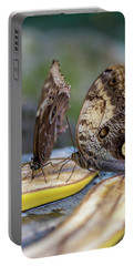 Portable Battery Charger featuring the photograph Butterflies Eating Bananas by Raphael Lopez