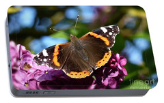 Portable Battery Charger featuring the photograph Butterfly 12 by Jean Bernard Roussilhe