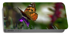 Portable Battery Charger featuring the photograph Butterfly In Winter by Debby Pueschel