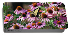 Portable Battery Charger featuring the photograph Butterfly On Coneflowers by Trina Ansel