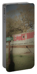Portable Battery Charger featuring the photograph Byron Town By The Tracks by Aaron Martens