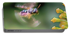 Portable Battery Charger featuring the photograph Bzzzzzzzz by Jivko Nakev