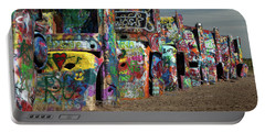 Portable Battery Charger featuring the photograph Cadillac Ranch by Tim Stanley