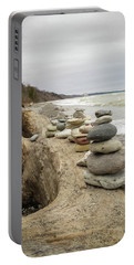 Cairn On The Beach Portable Battery Charger by Kimberly Mackowski