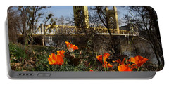 California Poppies With The Slightly Photographically Blurred Sacramento Tower Bridge In The Back Portable Battery Charger