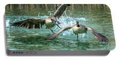 Canada Geese Chase 4906 Portable Battery Charger by Tam Ryan