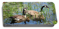 Canada Geese Family On Lily Pond Portable Battery Charger