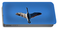Candian Goose In Flight 1648 Portable Battery Charger by Michael Peychich