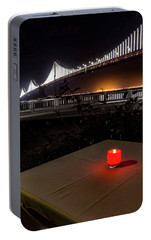 Portable Battery Charger featuring the photograph Candle Lit Table Under The Bridge by Darcy Michaelchuk
