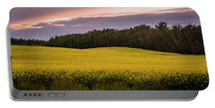 Portable Battery Charger featuring the photograph Canola Crop Sunset by Darcy Michaelchuk
